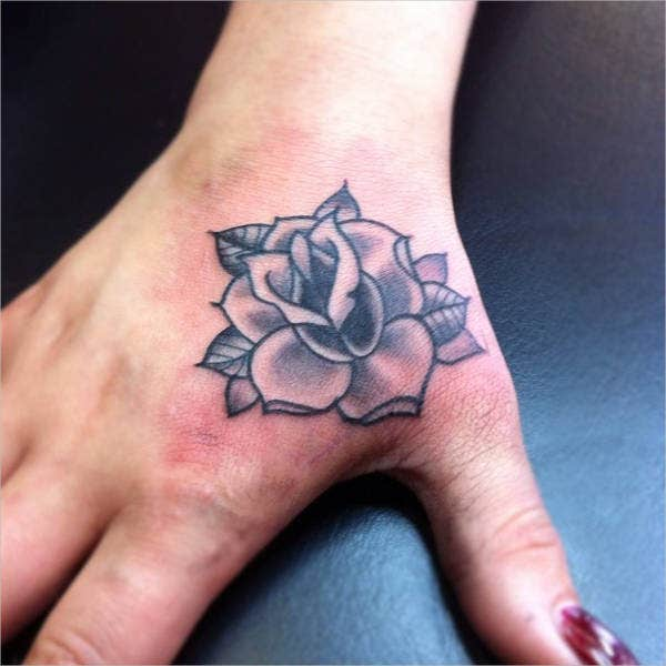 small rose on a girls hand