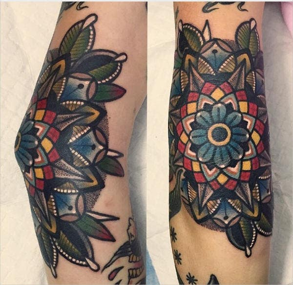 geometric flower elbow tattoo