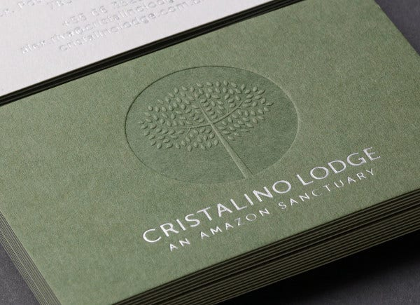 embossed business card by cristalino lodge