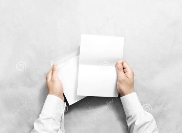 hand-holding-blank-envelope-mockup
